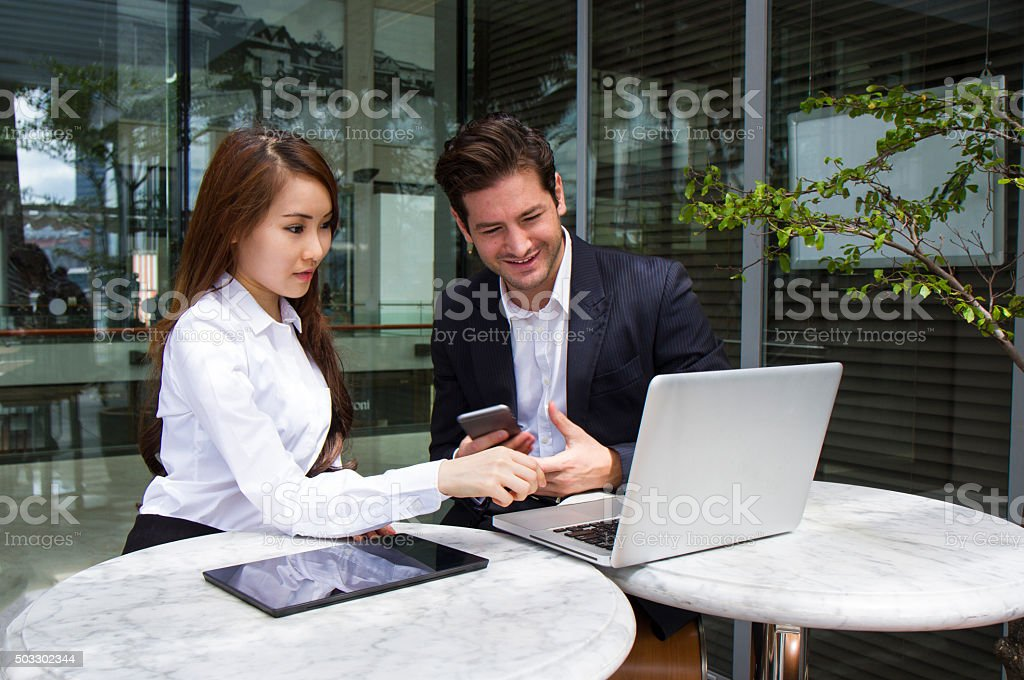 Multiracial Business Team working outdoors stock photo