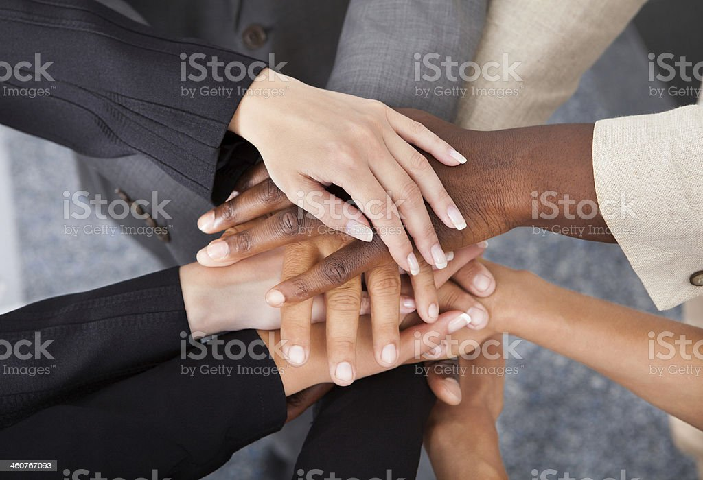 Multiracial Businesspeople Stacking Hands stock photo