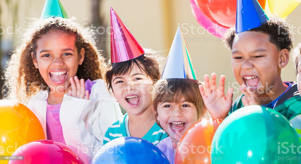 Multiracial children at a birthday party stock photo