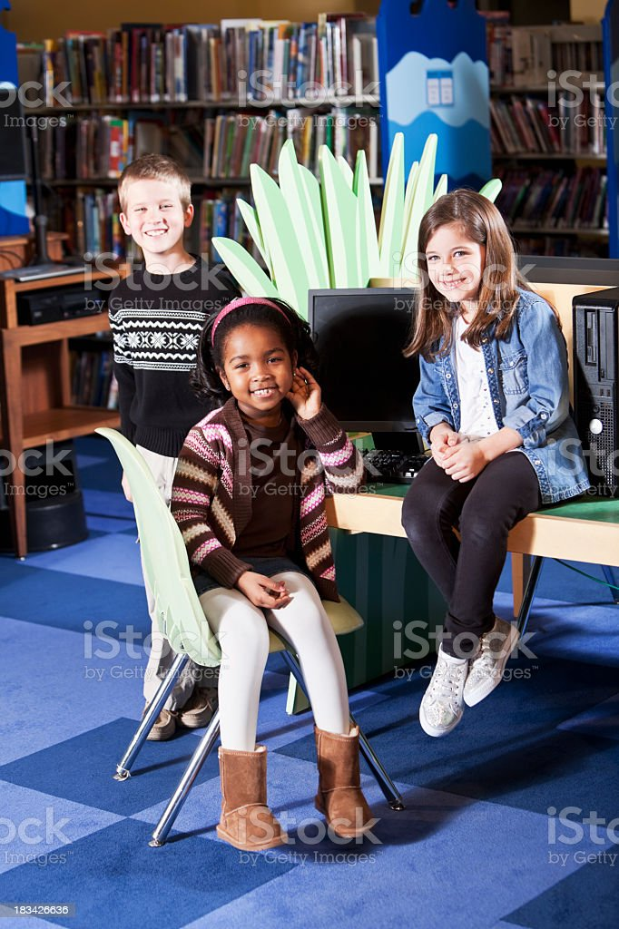 Multiracial children at the library stock photo