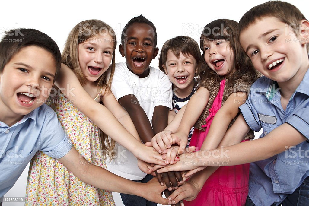 Multiracial children putting their hands together royalty-free stock photo