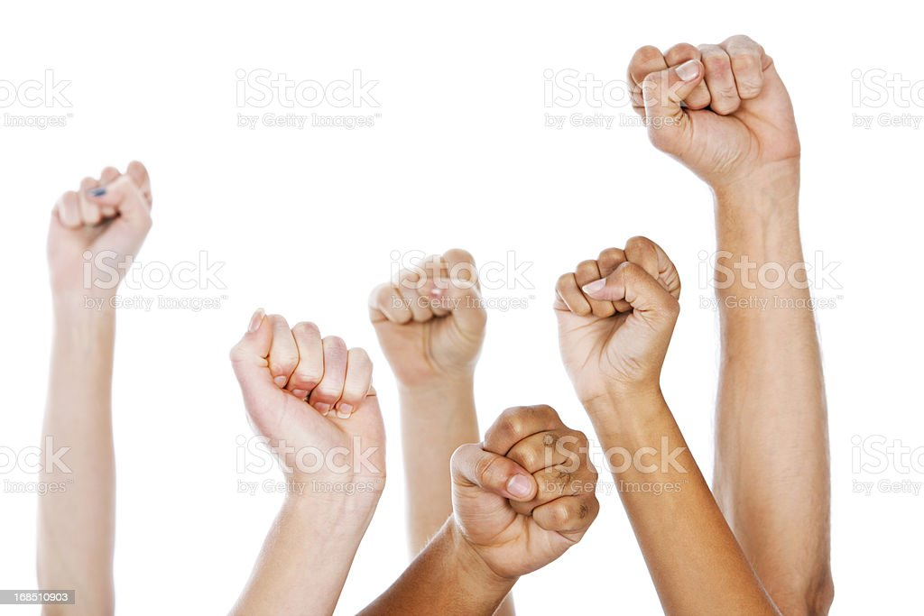 Multiracial clenched fists raised in the air against white background royalty-free stock photo