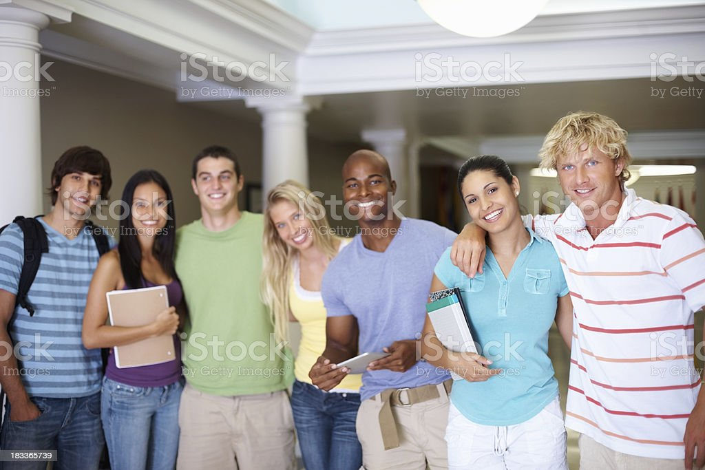 Multiracial college students standing together in a row royalty-free stock photo