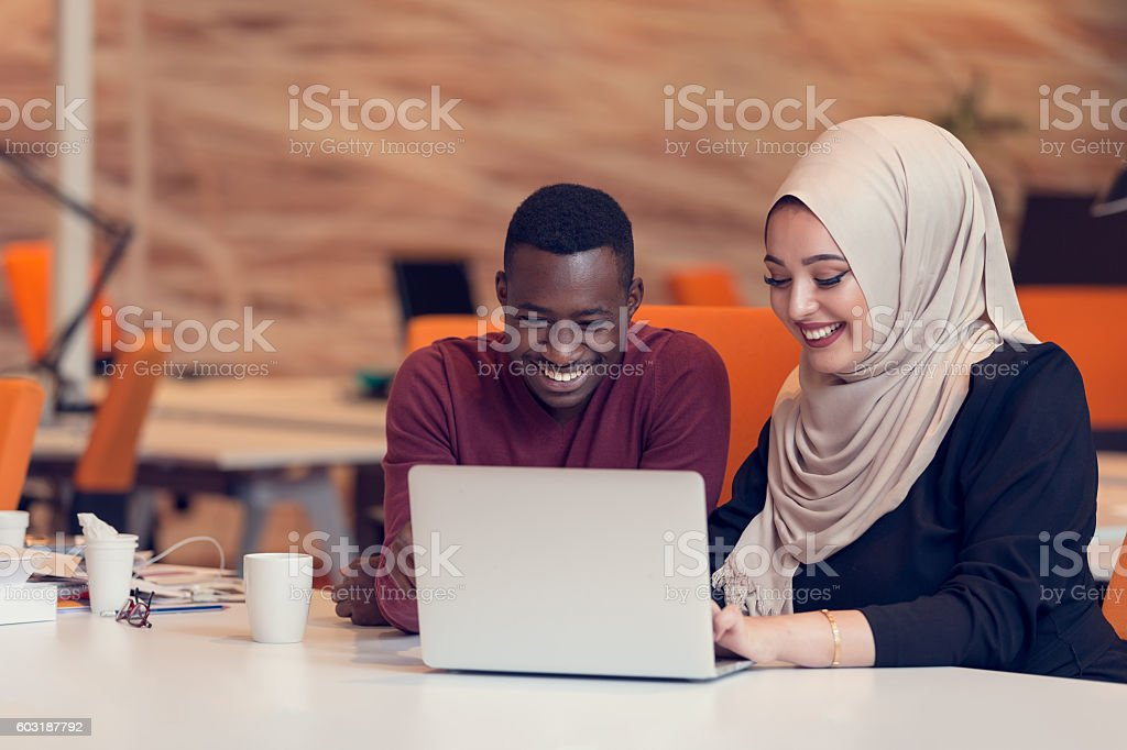 Multiracial contemporary business people working stock photo