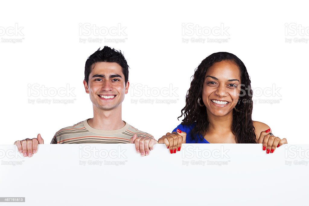 Multiracial couple holding a blank banner royalty-free stock photo