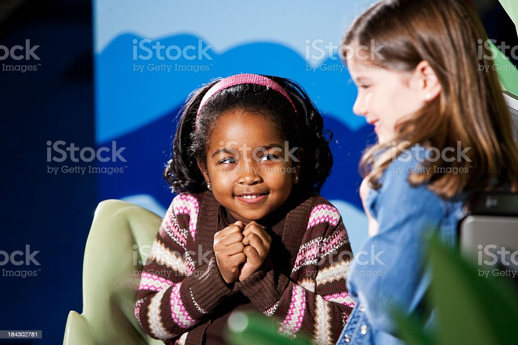 Multiracial elementary school girls stock photo