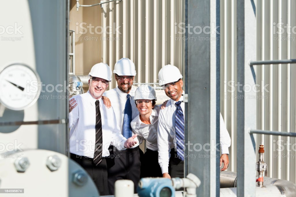 Multiracial engineers at industrial site royalty-free stock photo