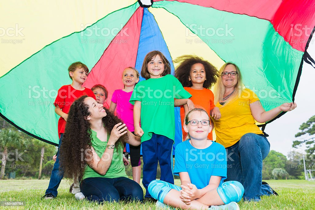 Multiracial group of children,  counselors at summer camp stock photo