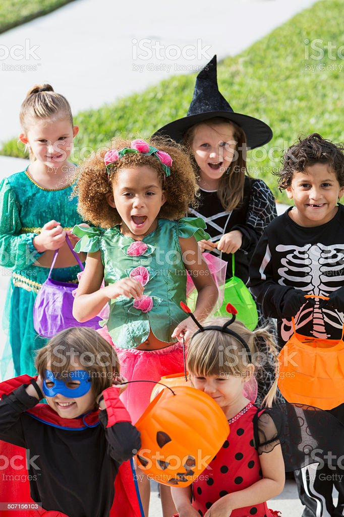 Multi-racial group of children in halloween costumes stock photo