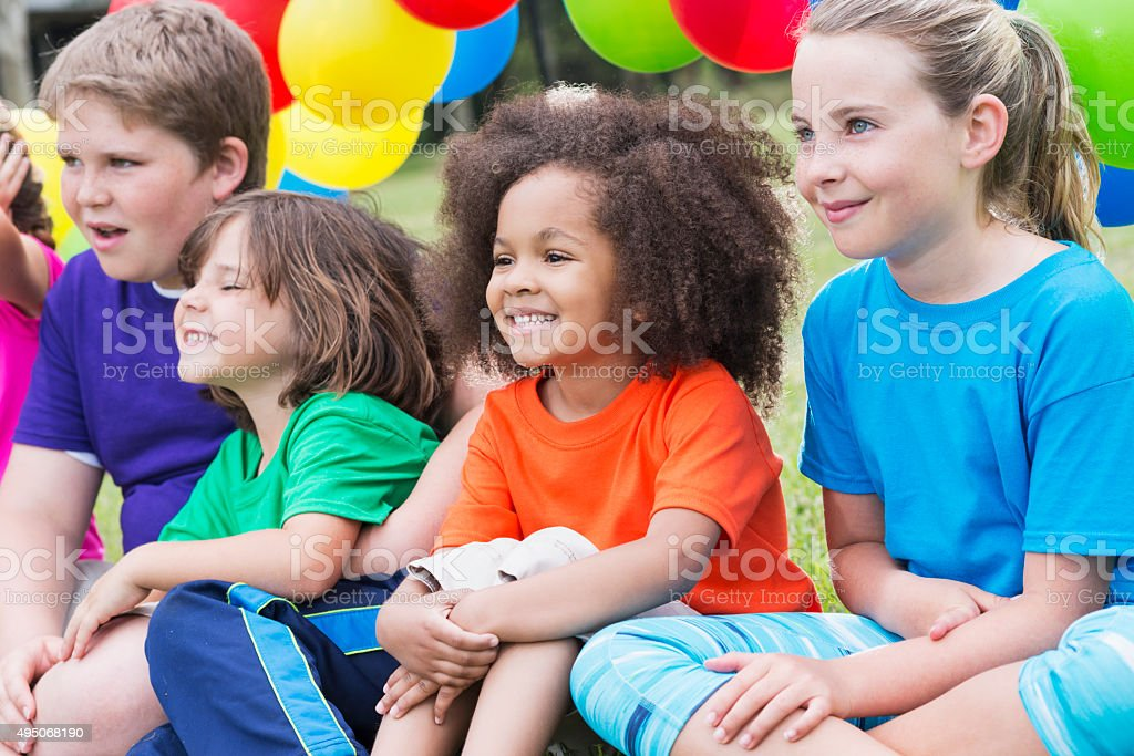 Multiracial group of children in summer camp stock photo