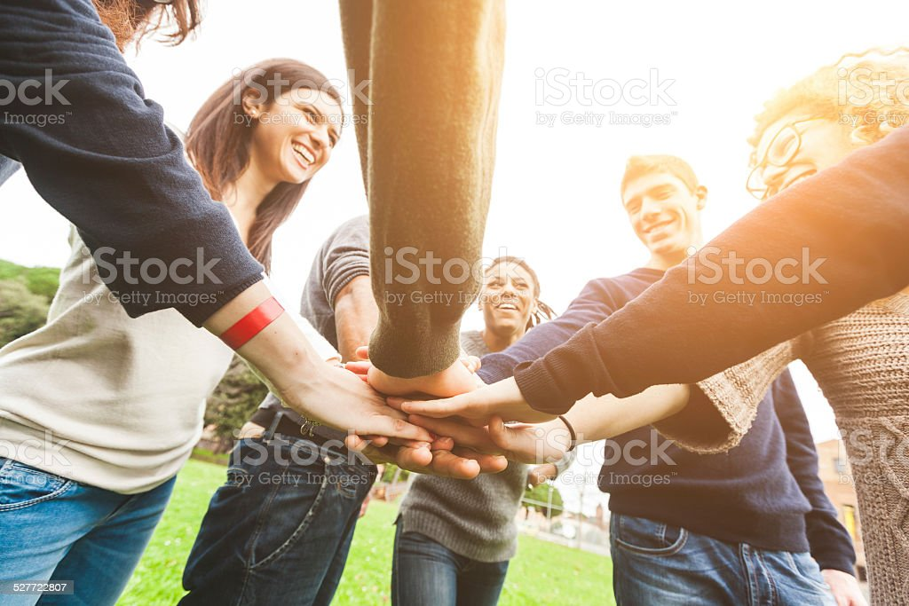 Multiracial Group of Friends with Hands in Stack, Teamwork stock photo
