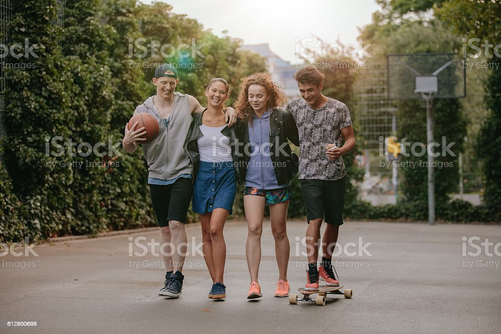 Multiracial group of people enjoying a walk stock photo