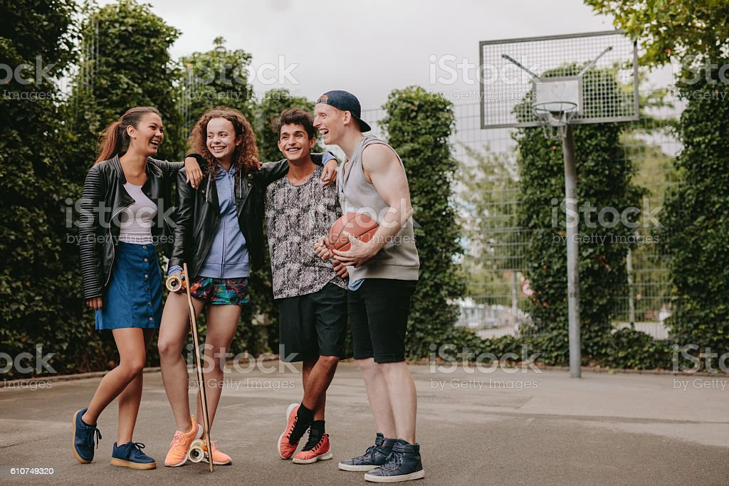 Multiracial group of people on basketball court stock photo