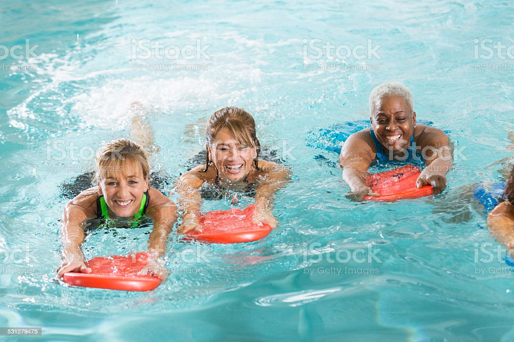 Multiracial group of woman in swimming pool stock photo
