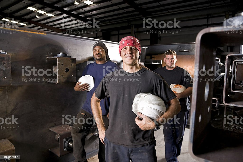 Multiracial industrial workers standing in factory stock photo