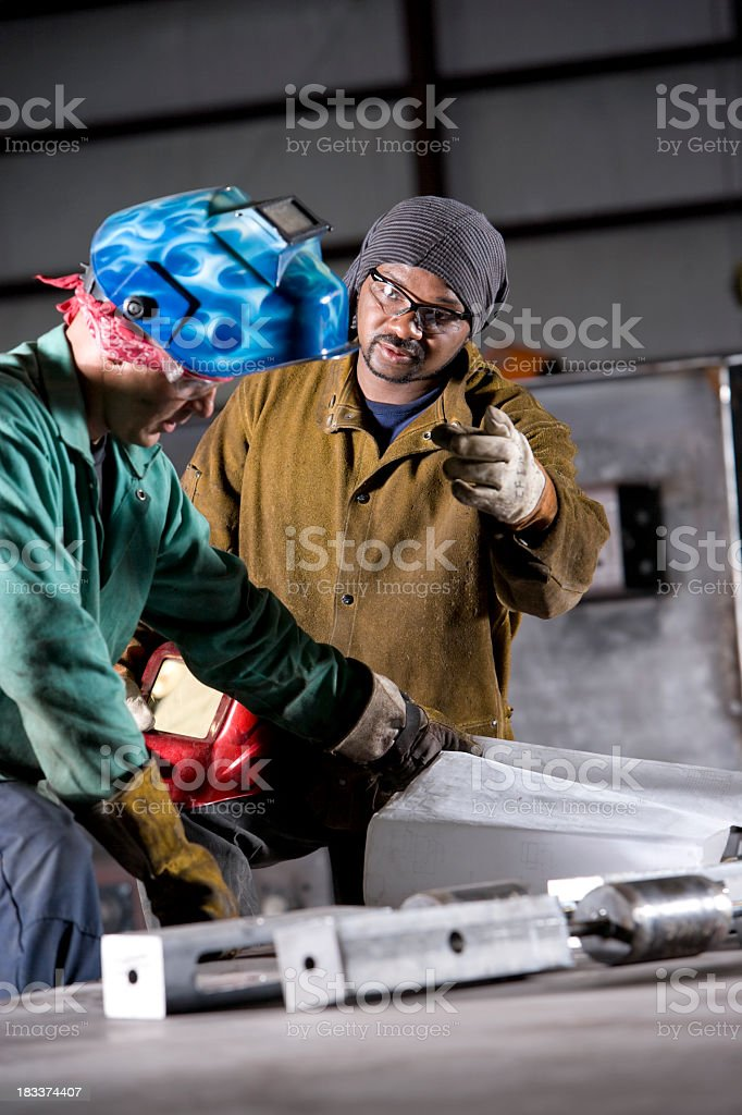 Multiracial industrial workers with welding tools stock photo