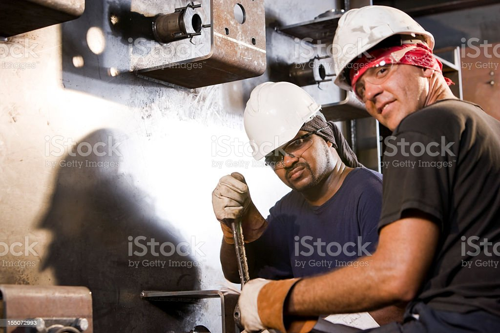 Multiracial industrial workers working machinery royalty-free stock photo