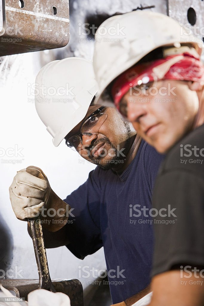 Multiracial industrial workers working machinery stock photo