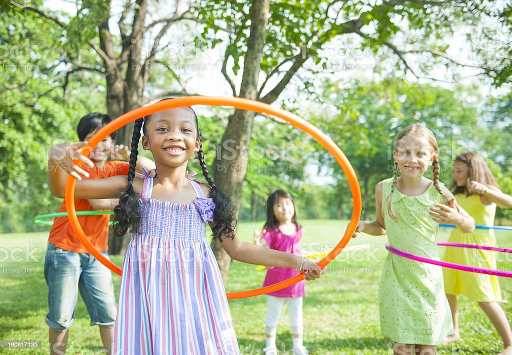 Multiracial kids playing hoops outside stock photo