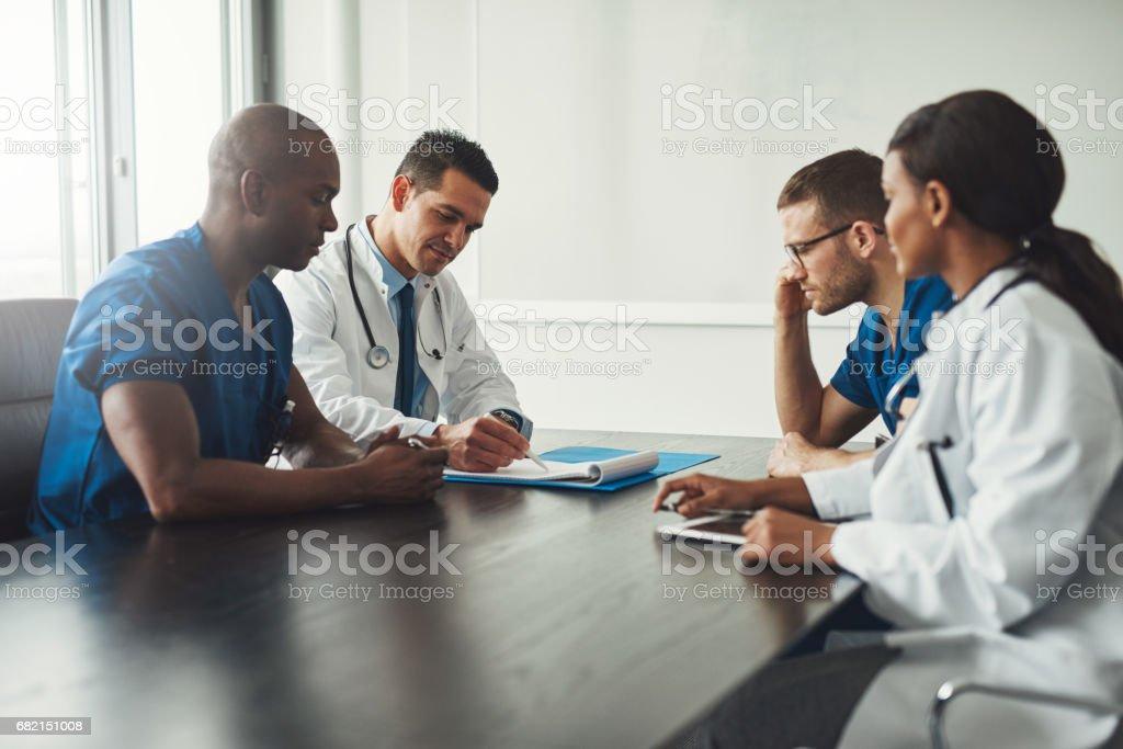 Multiracial medical team having a meeting stock photo