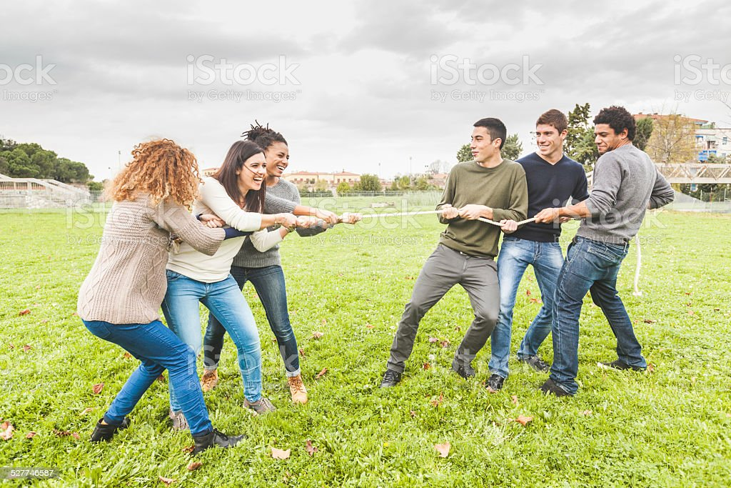 Multiracial People Playing Tug of War stock photo