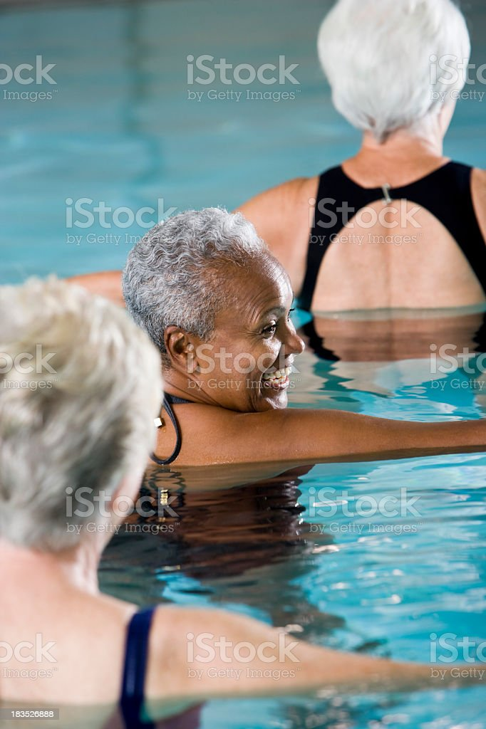 Multiracial senior women in water aerobics class royalty-free stock photo