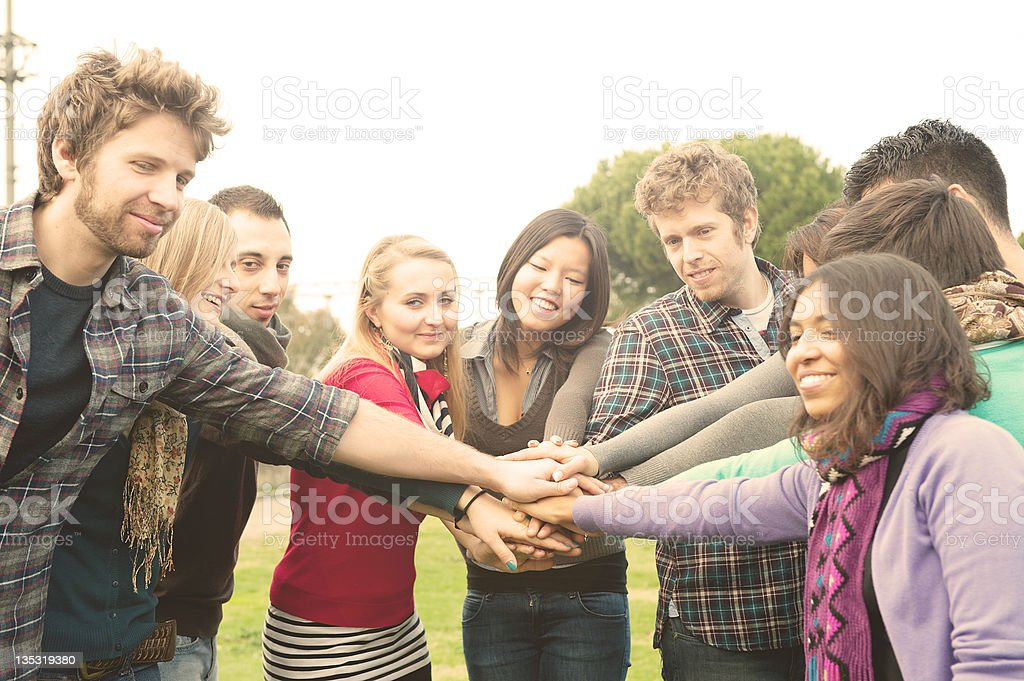 Multiracial Students whit hands on stack royalty-free stock photo