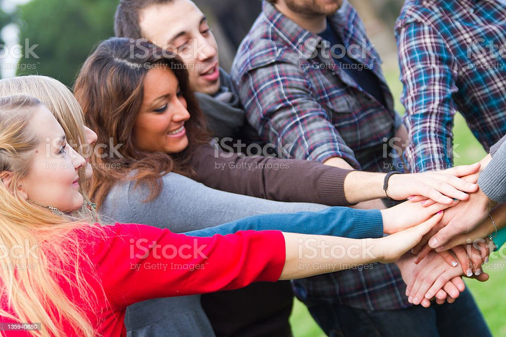 Multiracial Students with Hands on Stack royalty-free stock photo