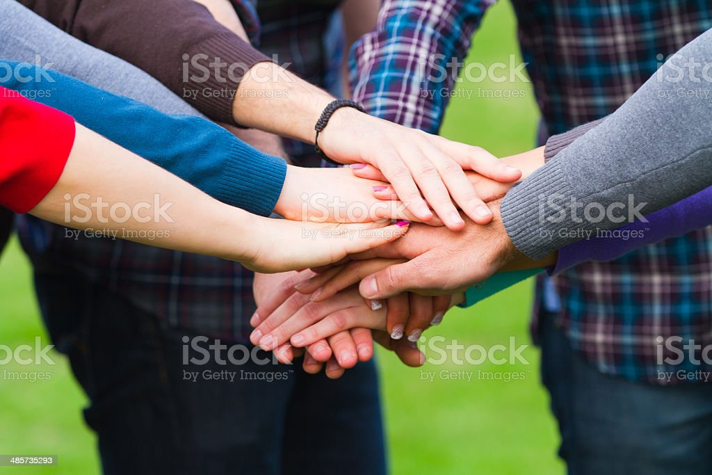 Multiracial Students with Hands on Stack stock photo