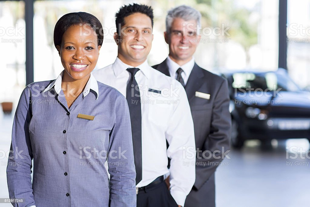 multiracial vehicle sales team stock photo