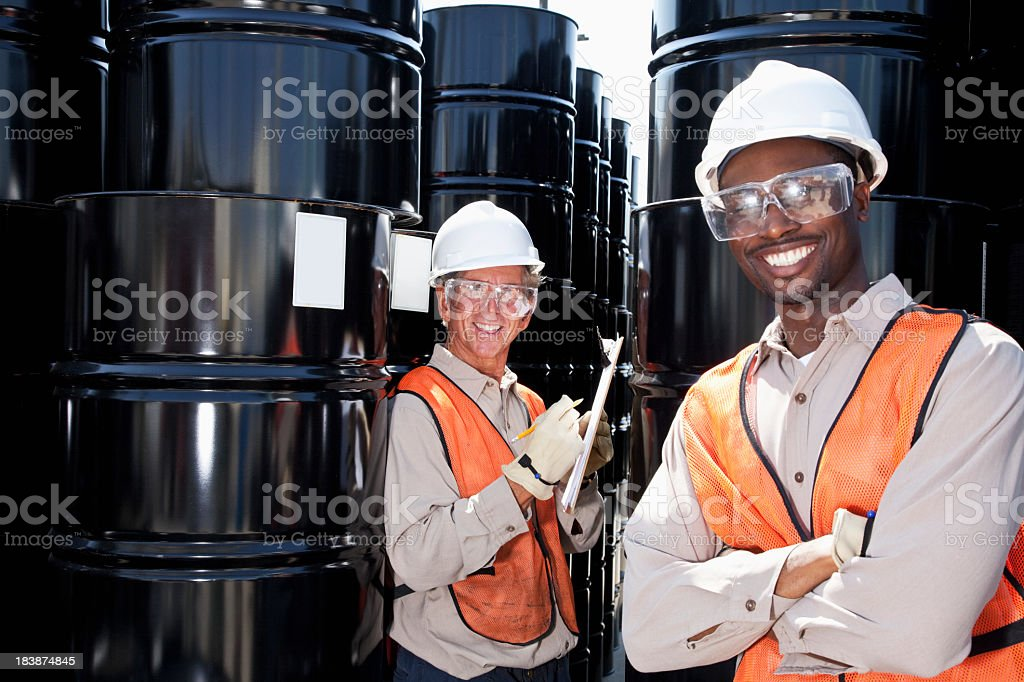Multiracial workers at chemical plant stock photo