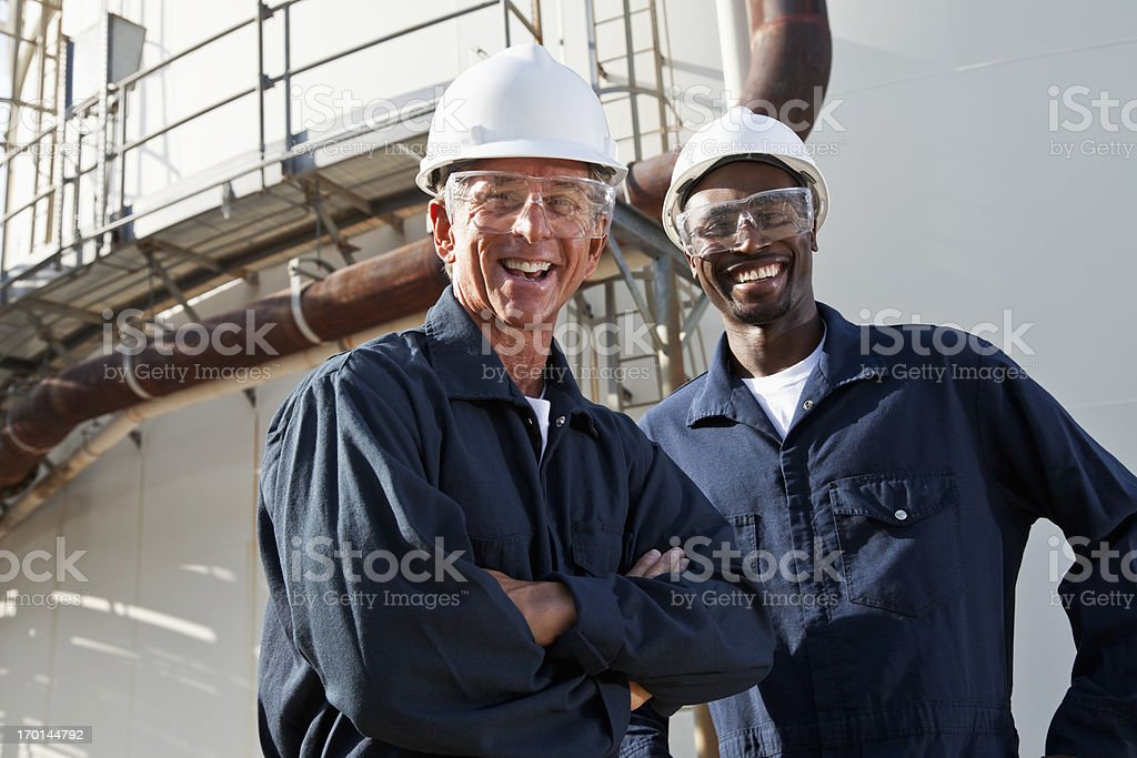 Multiracial workers at industrial plant royalty-free stock photo