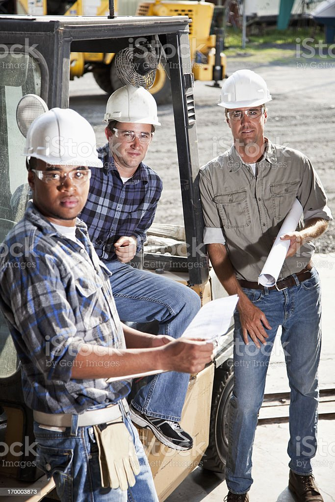 Multiracial workers with forklift royalty-free stock photo