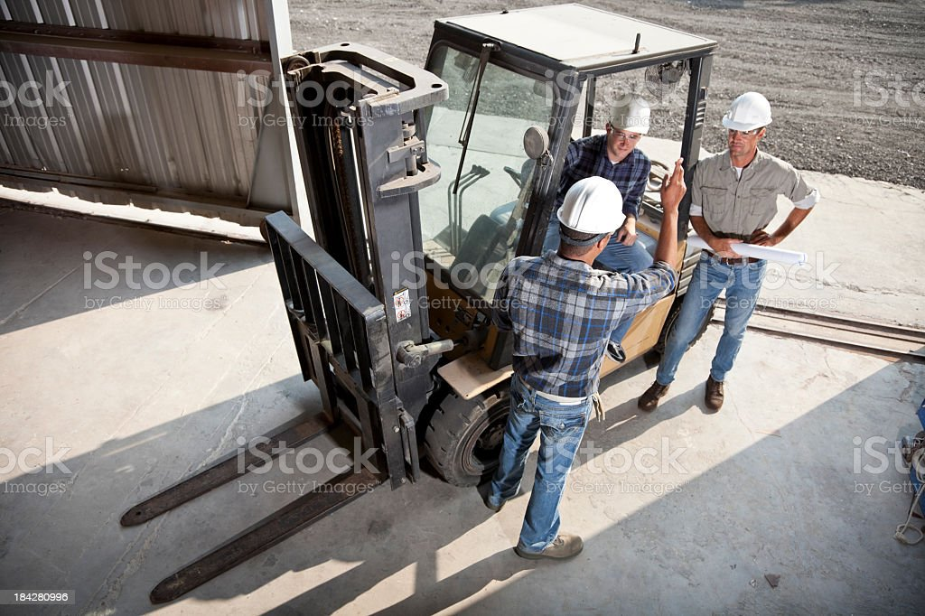 Multiracial workers with forklift stock photo
