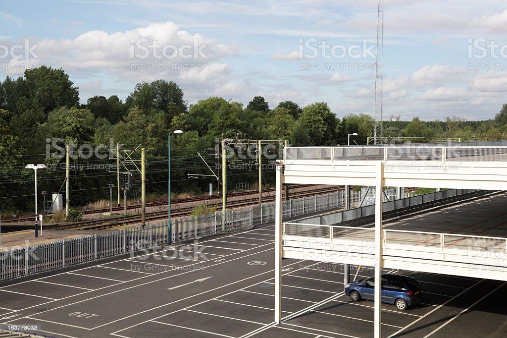 multi-storey car park beside railway line royalty-free stock photo