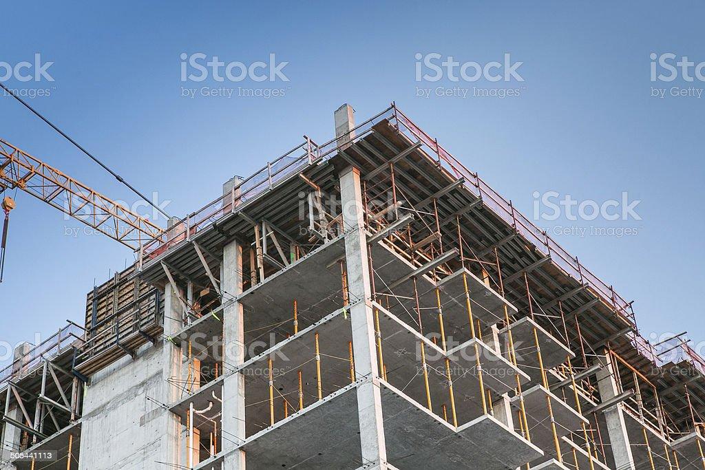 multistory apartment building under construction concrete stock photo