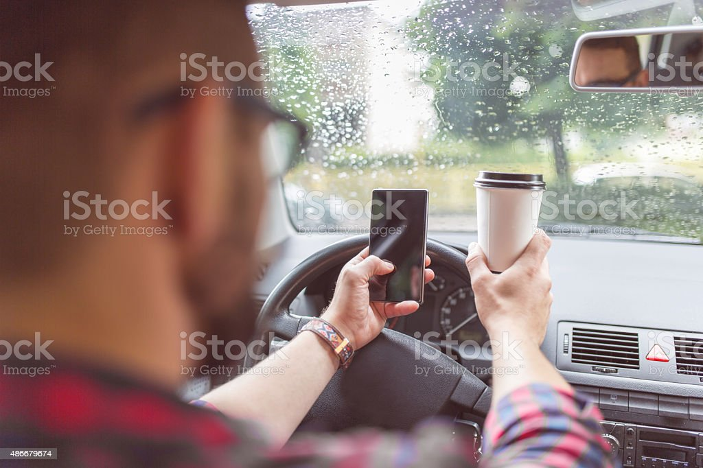 Multi-task driver is not a good idea stock photo
