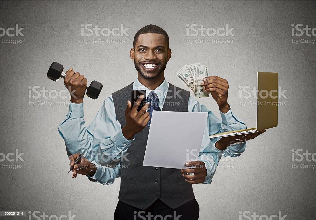 Multitasking business man stock photo