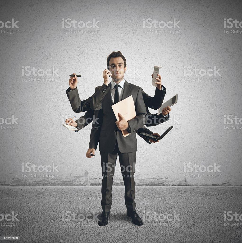 Multitasking businessman stock photo
