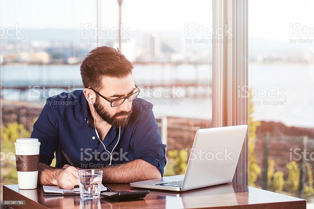Multi-tasking businessman stock photo