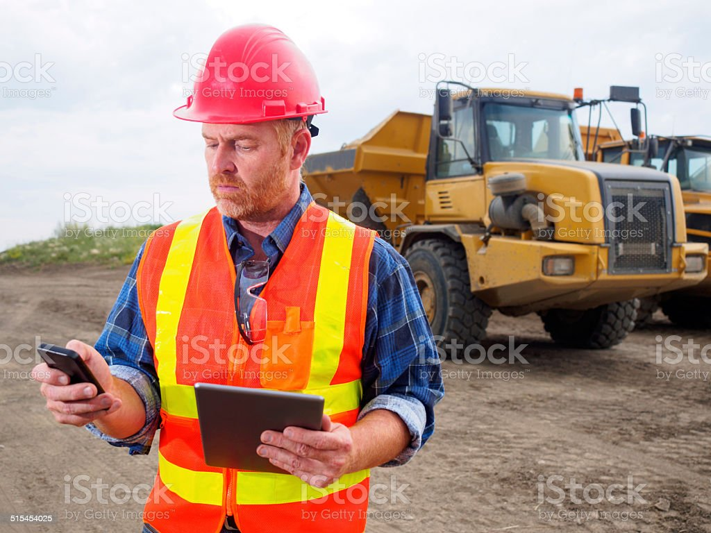 Multitasking Construction Engineer stock photo
