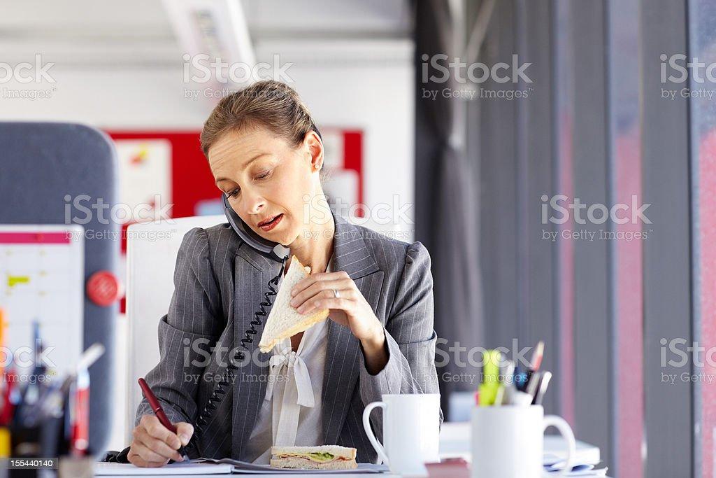 Multitasking Female Professional stock photo