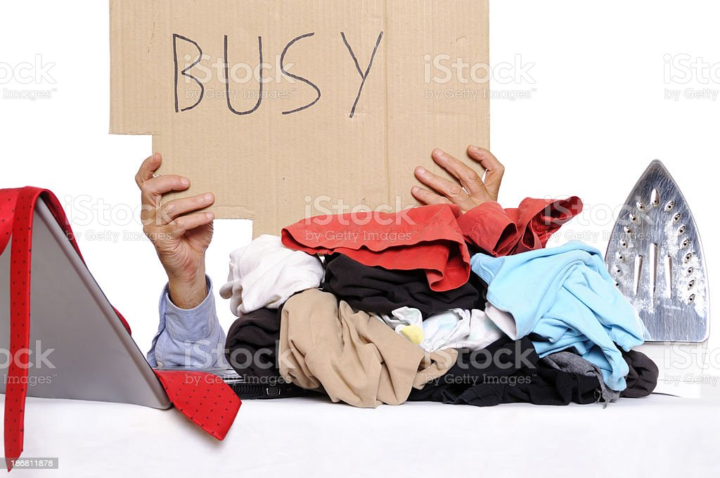 Multi-Tasking House Husband Holding Busy Message royalty-free stock photo