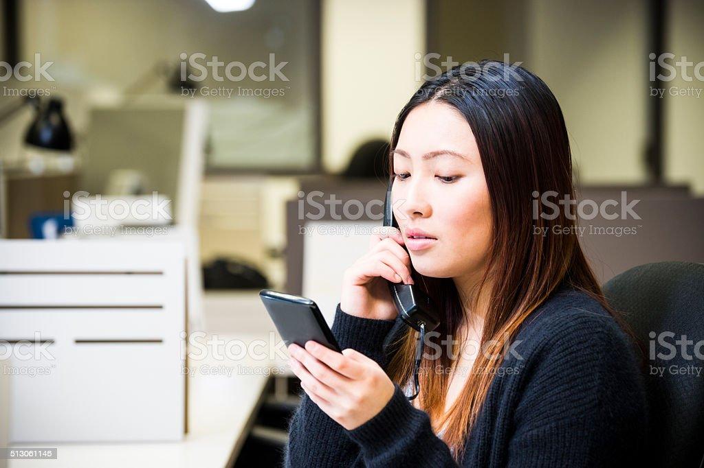 Multi-tasking in an office stock photo