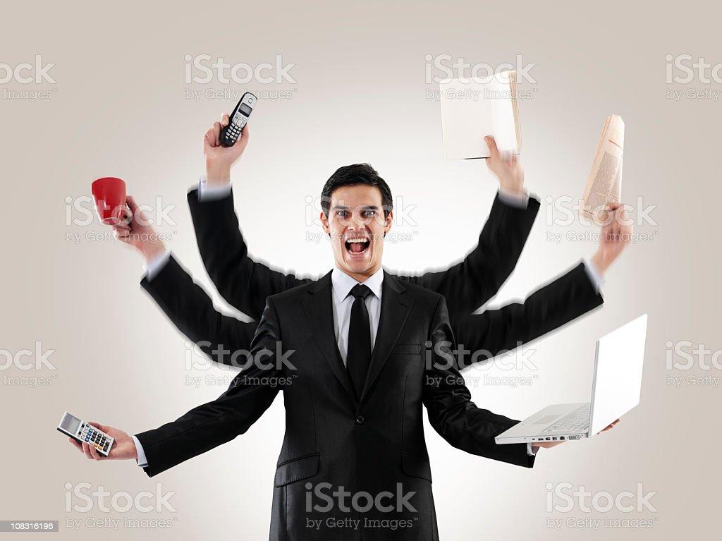 Multi-tasking man stock photo
