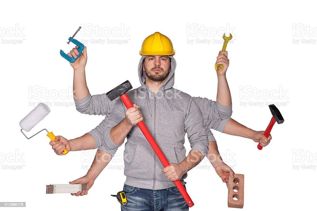 Multitasking worker with plenty of tools stock photo
