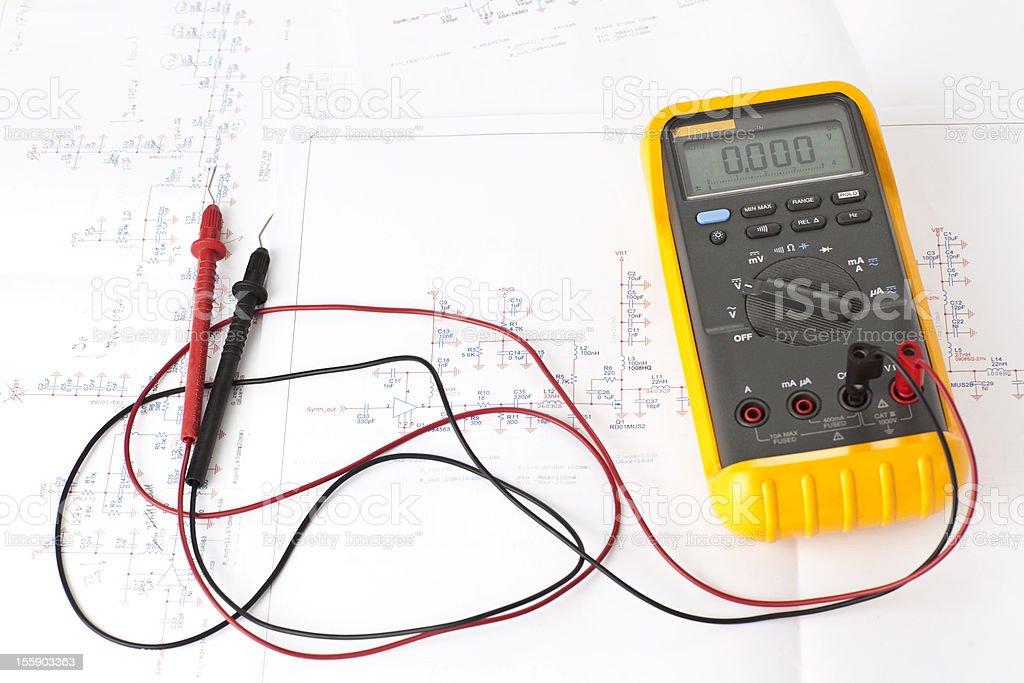 Multitester tool on electronic scheme diagram. stock photo