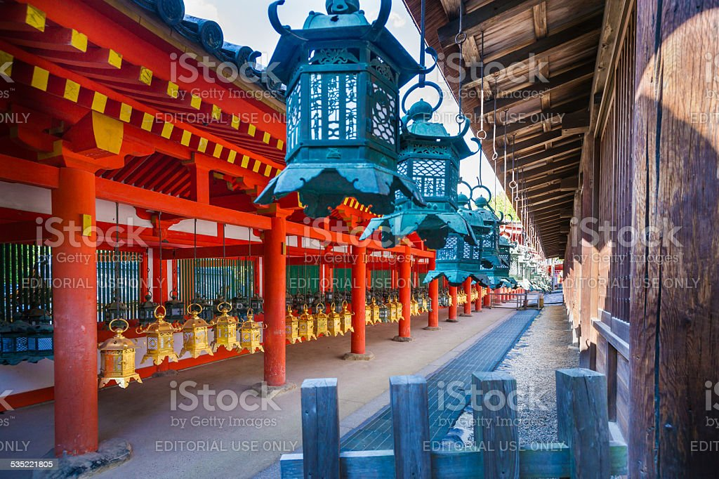Multitude of Bronze lanterns at Shinto Shrine on Honshu, Japan stock photo
