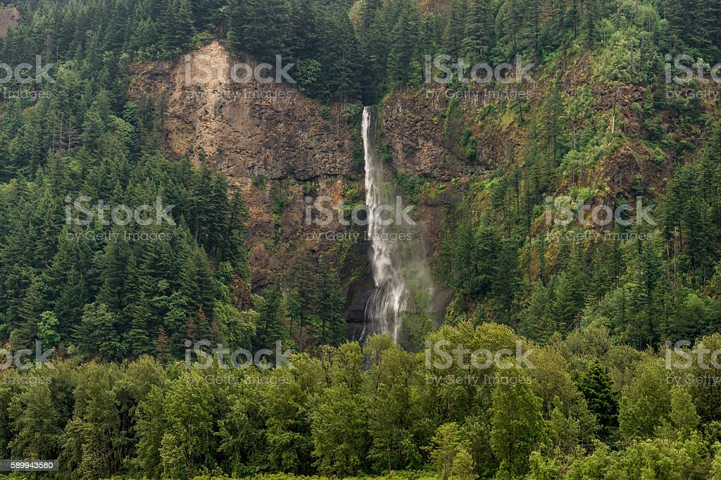 Multnomah Falls Waterfall Wind Blown from on Columbia River Oregon stock photo