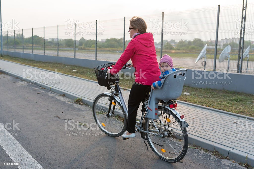 Mum and son traveling by bicycle stock photo